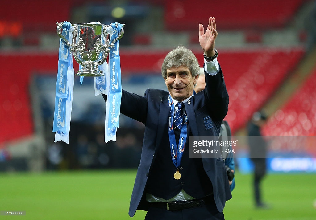 Manuel Pellegrini manager of Manchester City celebrates with the trophy after the Capital One Cup Final match between Liverpool and Manchester City at Wembley Stadium on February 28, 2016 in London, England.