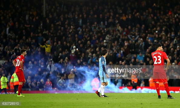 LIVERPOOL, ENGLAND - DECEMBER 31: Manchester City supporters throw a flair onto the pitch during the Premier League match between Liverpool and Manchester City at Anfield on December 31, 2016 in Liverpool, England. (Photo by Clive Brunskill/Getty Images)